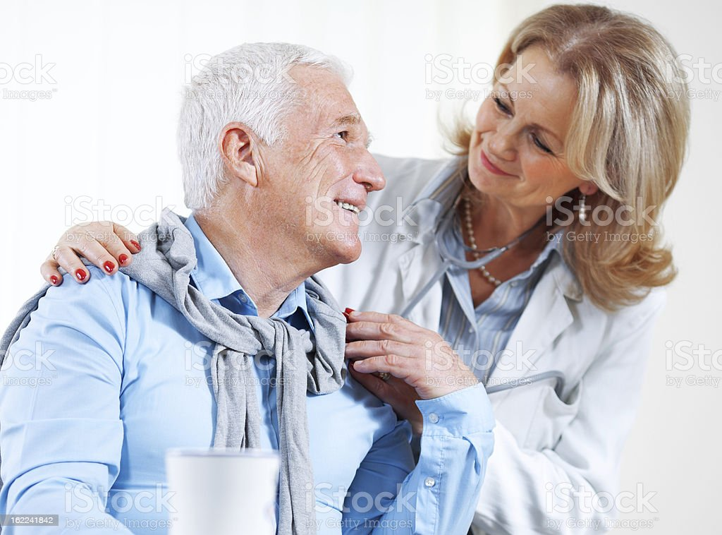 Female doctor with senior patient royalty-free stock photo
