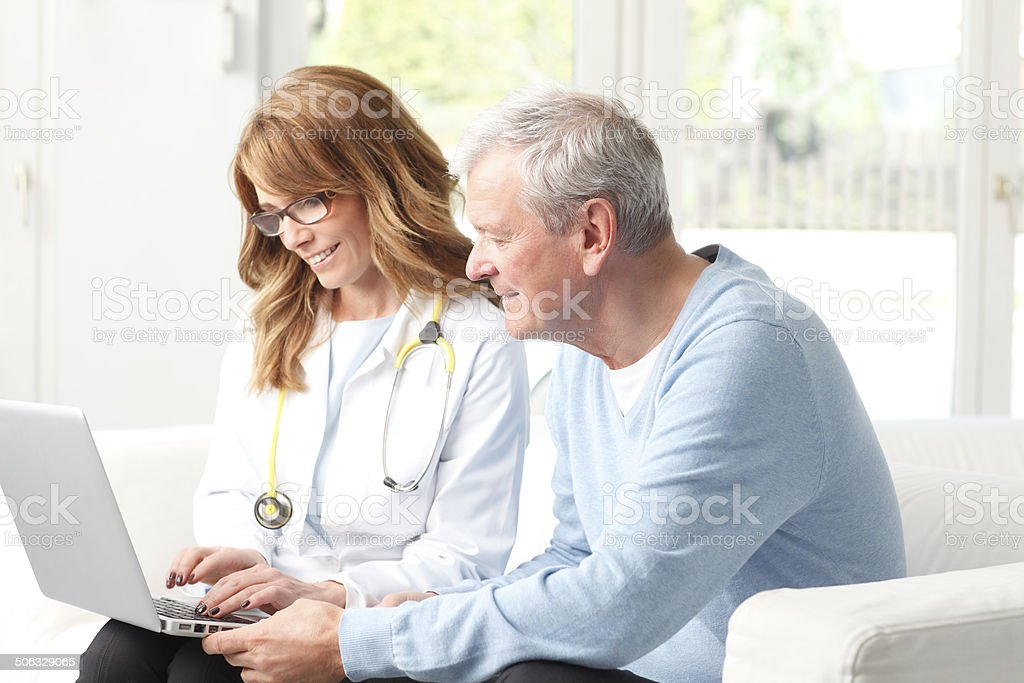 Female doctor with senior patient stock photo