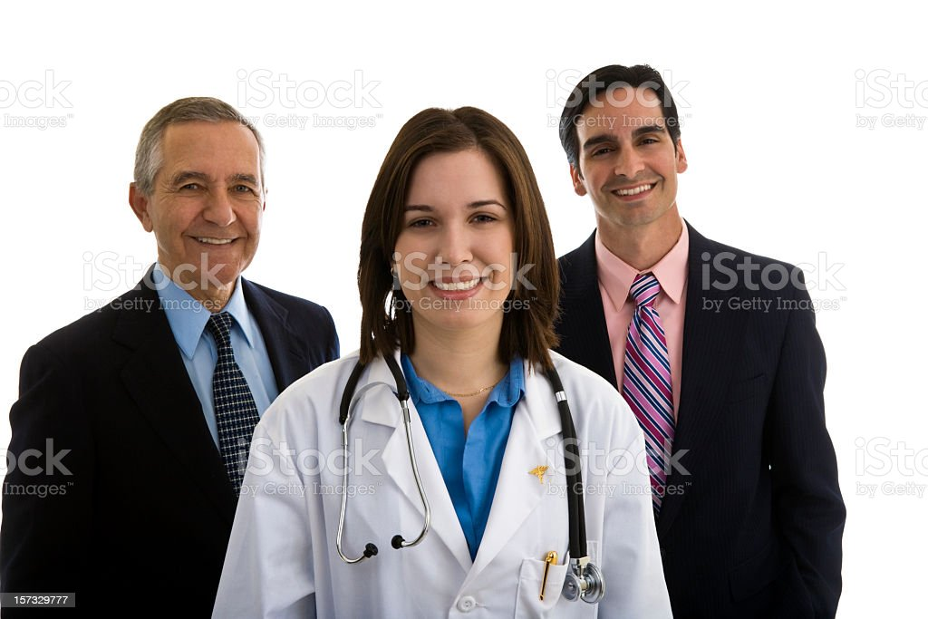 Female Doctor with two men in suits behind them royalty-free stock photo