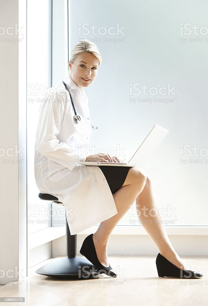 Female Doctor Working on Laptop At The Hospital royalty-free stock photo