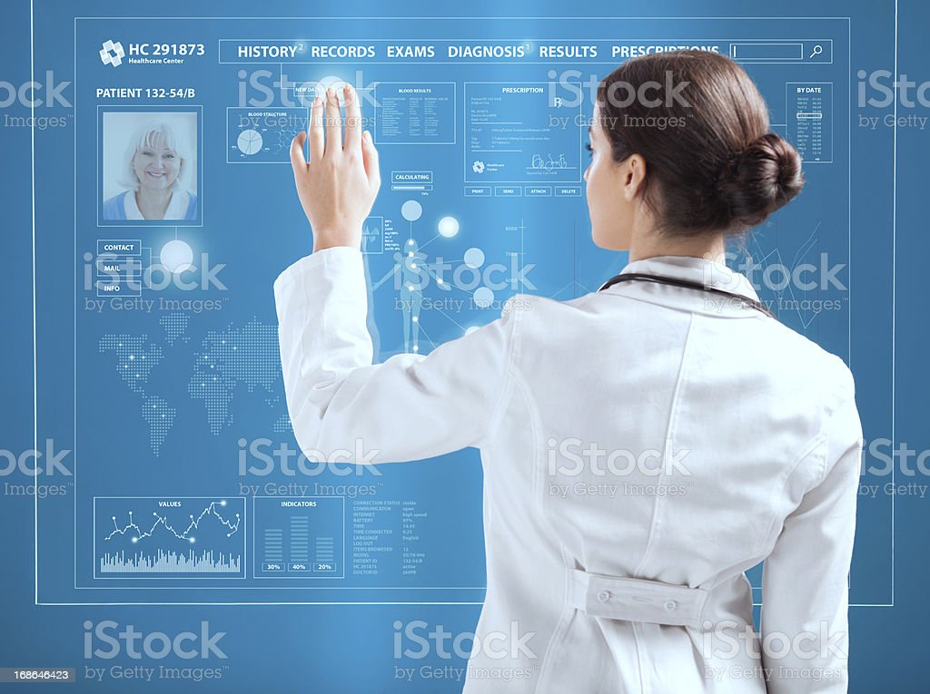 Female doctor working on transparent monitor. stock photo