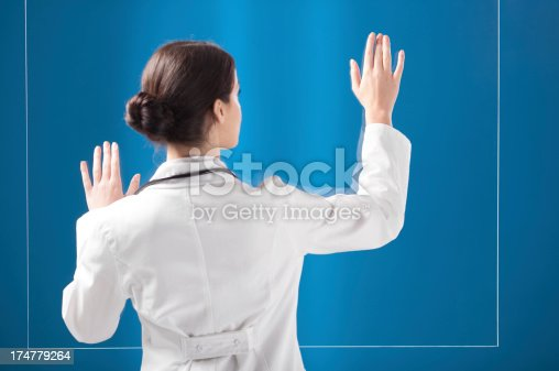 527567107 istock photo Female doctor working on transparent monitor 174779264