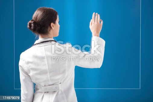 527567107 istock photo Female doctor working on transparent monitor. 174979079