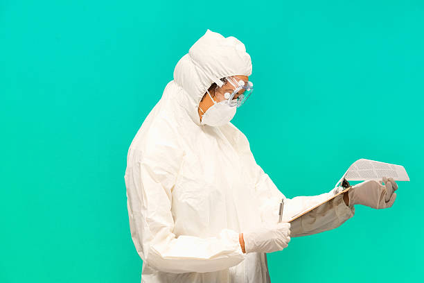 Female doctor working with clipboard stock photo