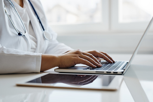istock Female doctor working with her laptop 1139629383