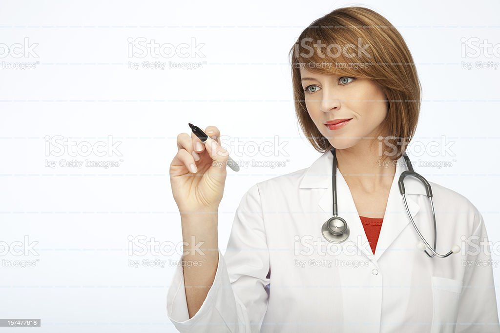 Female Doctor Writing royalty-free stock photo