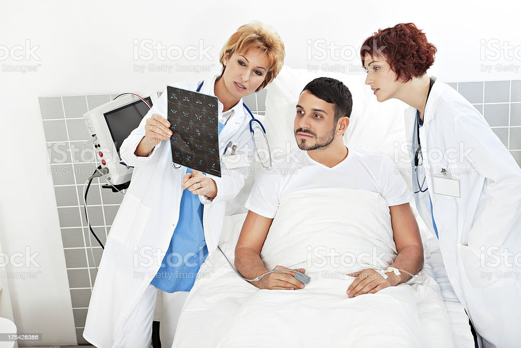 Female doctors explaining an MR exposure to a patient royalty-free stock photo
