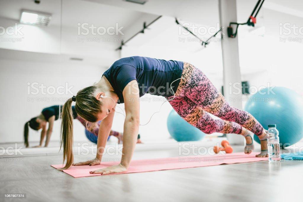 Female Doing Running Planks stock photo