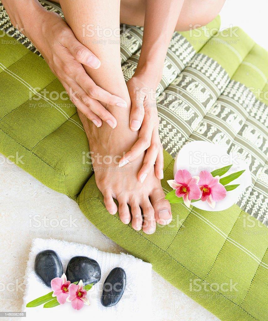 Female doing self foot massage royalty-free stock photo