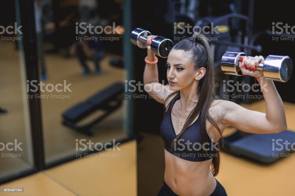 Female doing shoulder workout stock photo