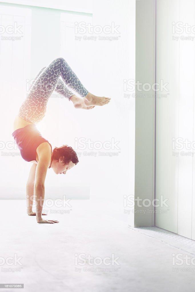 Female doing yoga exercise stock photo