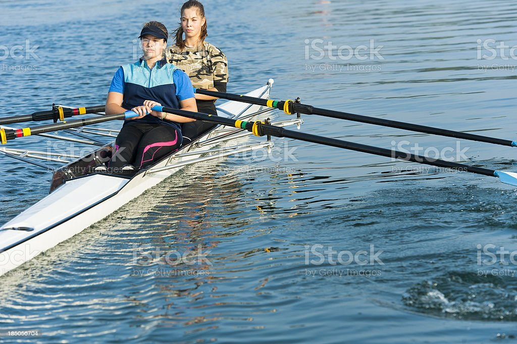 Female double scull rowing team stock photo