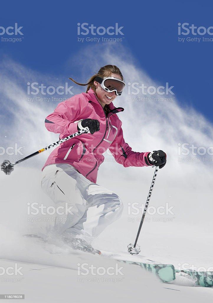Female Downhill Skier Snowplowing royalty-free stock photo