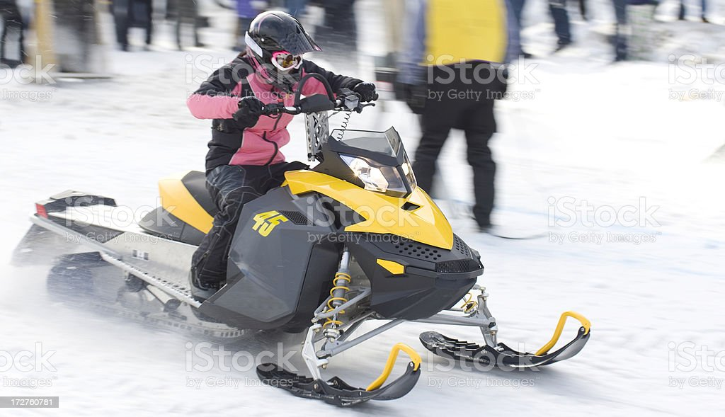 Female driver at snowmobile drag races royalty-free stock photo