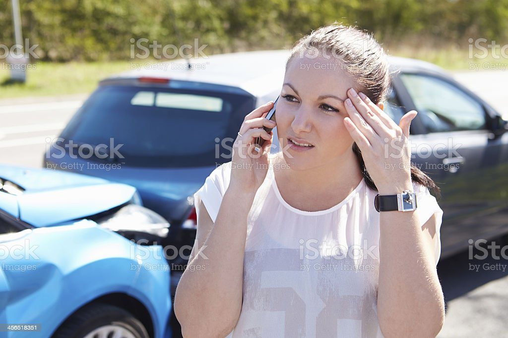 Female driver calling after being involved in accident stock photo