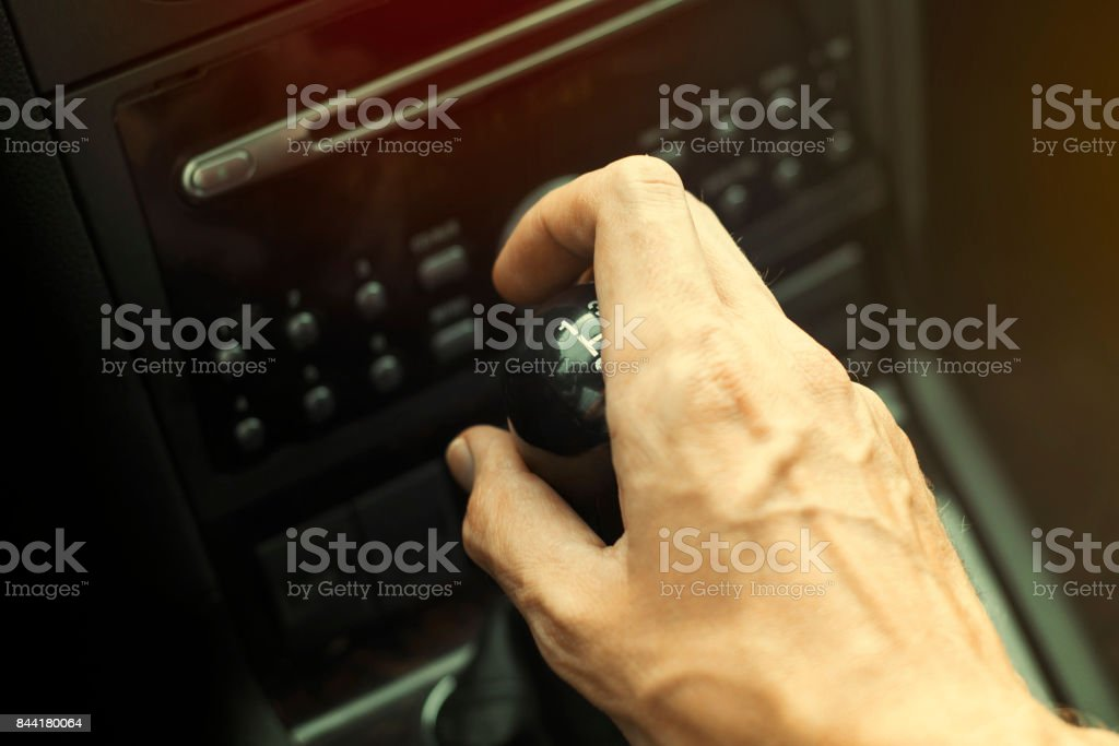 Female driver hand shifting gear manually, selective focus stock photo