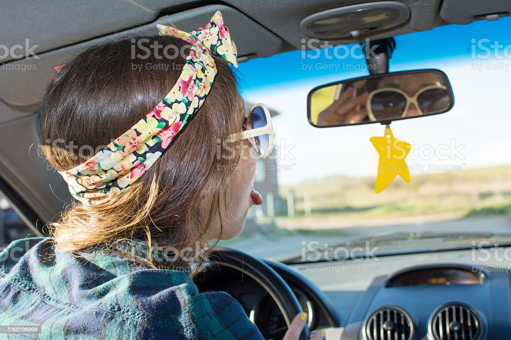 Female driver in a car stock photo