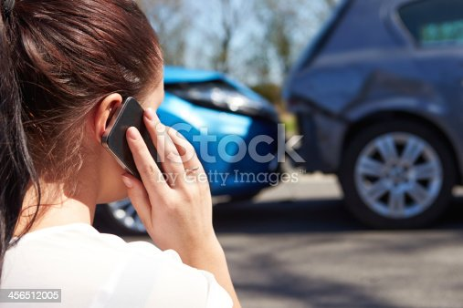 istock Female Driver Making Phone Call After Traffic Accident 456512005