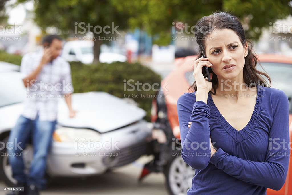 Female Driver Making Phone Call After Traffic Accident stock photo