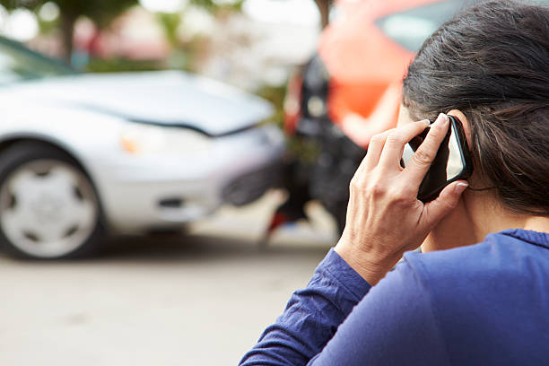 female driver making phone call after traffic accident - krockad bil bildbanksfoton och bilder