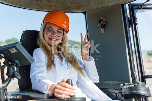 Female driving a compactor on the worksite