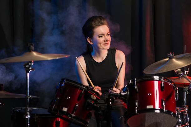 Female drummer at drumset in club stock photo