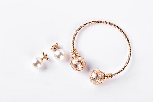 istock Female earings and bracelet on white background. 871536618