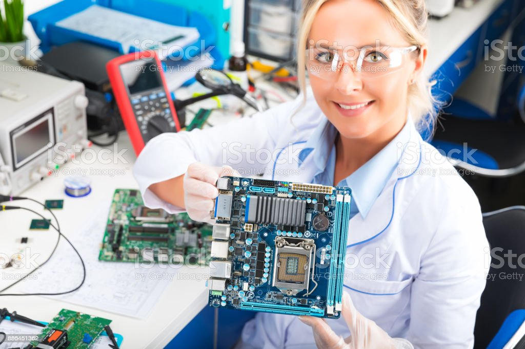 female electronic engineer holding computer motherboard 1024 x 682 · jpeg