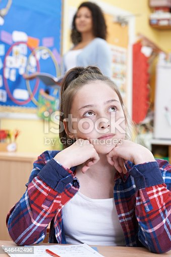 Female Elementary School Pupil Daydreaming In Class Stock ...