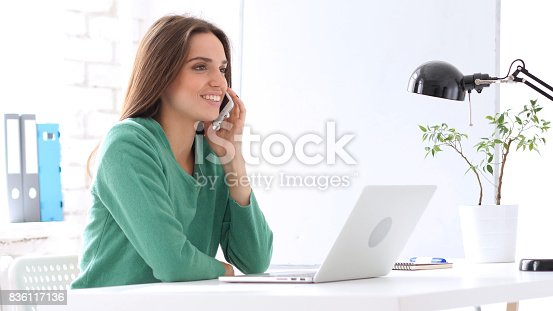 istock Female Employee Talking on Smartphone 836117136