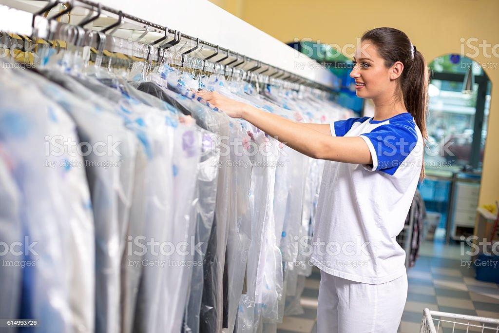 Female employees checks clothes stock photo