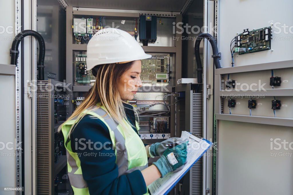 Female Energy Station Electrician Engineer Read Notes stock photo