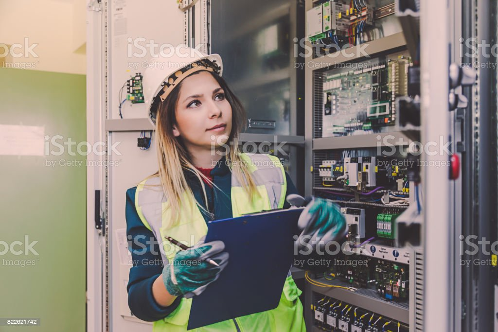 Female Energy Station Electrician Engineer Working at Energy Control Room stock photo
