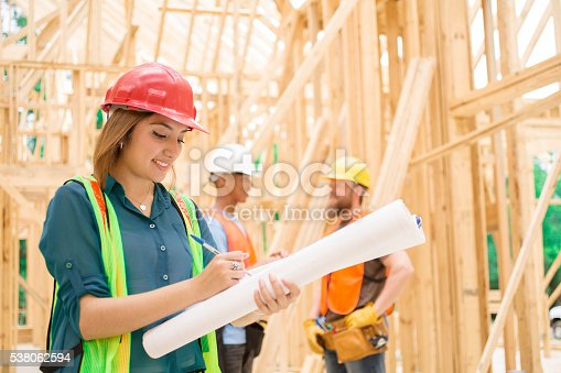 istock Female engineeer.  Construction job site. Framed building. 538062594