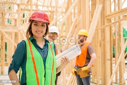 istock Female engineeer.  Construction job site. Framed building. 538166436