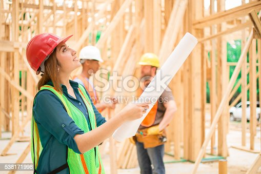 istock Female engineeer.  Construction job site. Framed building. 538171998