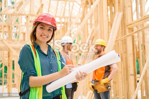 istock Female engineeer.  Construction job site. Framed building. 538175508