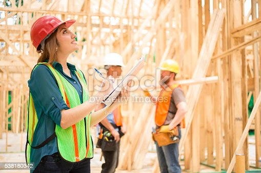 istock Female engineeer.  Construction job site. Framed building. 538180342