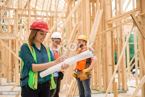istock Female engineeer.  Construction job site. Framed building. 538185870
