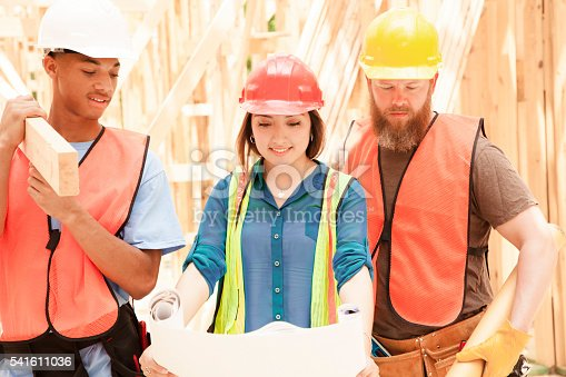istock Female engineeer.  Construction job site.  Framed building. 541611036