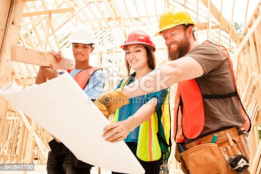 488715470istockphoto Female engineeer.  Construction job site.  Framed building. 541841150