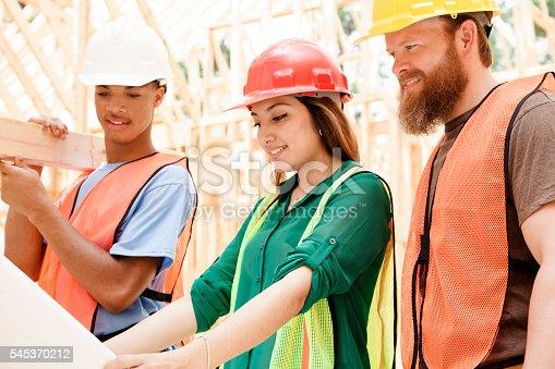 488715470istockphoto Female engineeer.  Construction job site.  Framed building. 545370212