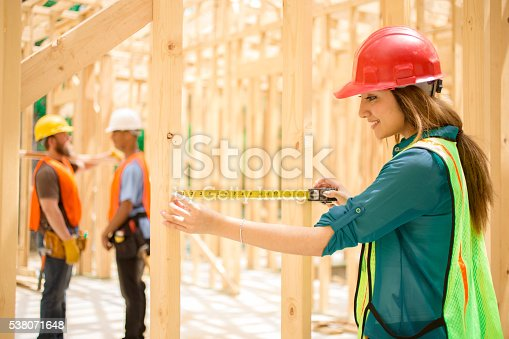 istock Female engineeer, inspector.  Construction job site. Framed building. 538071648