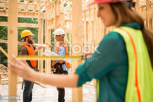 istock Female engineeer, inspector.  Construction job site. Framed building. 538177746