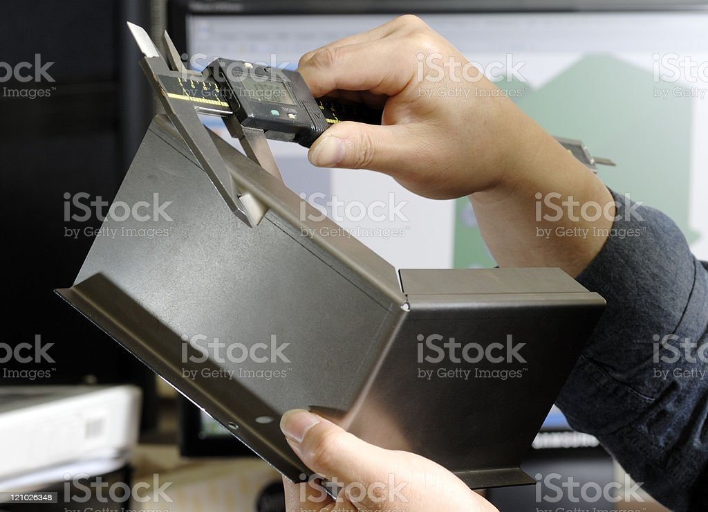 Female engineer checking manufactured part royalty-free stock photo