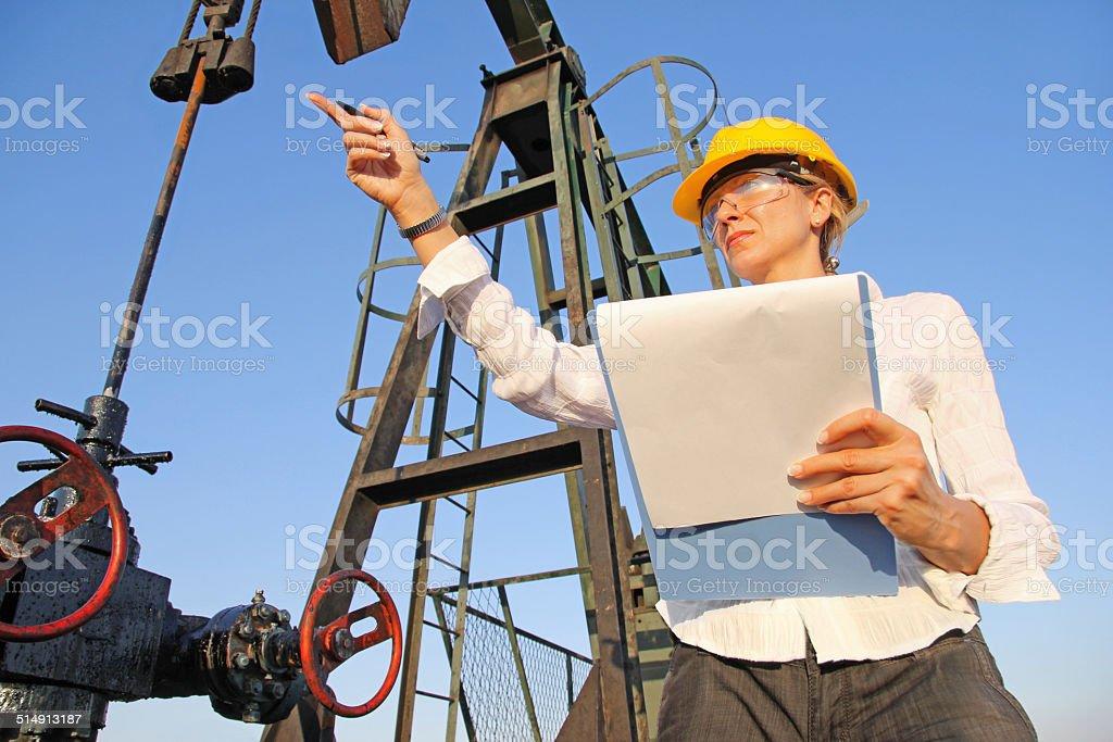 Female engineer in oil field stock photo