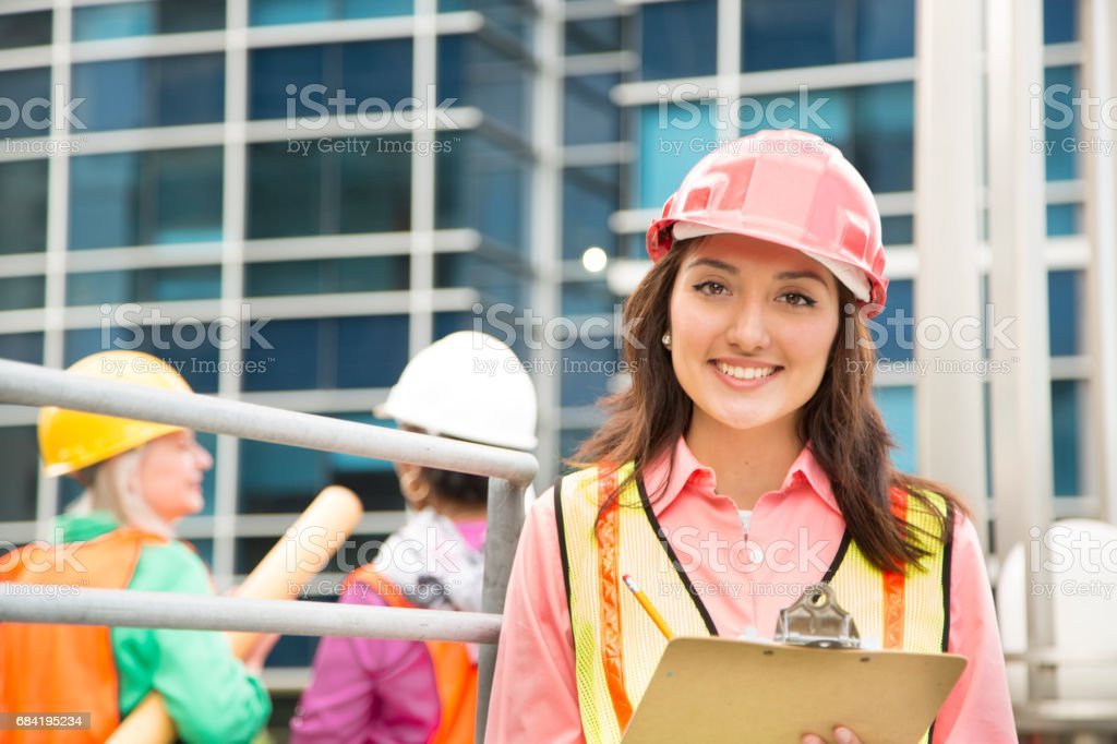 STEM Female engineer or architect team working on a construction project in city. royalty-free stock photo