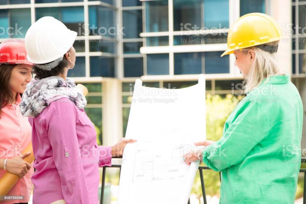STEM. Female engineer or architect team working on a construction project in city. stock photo