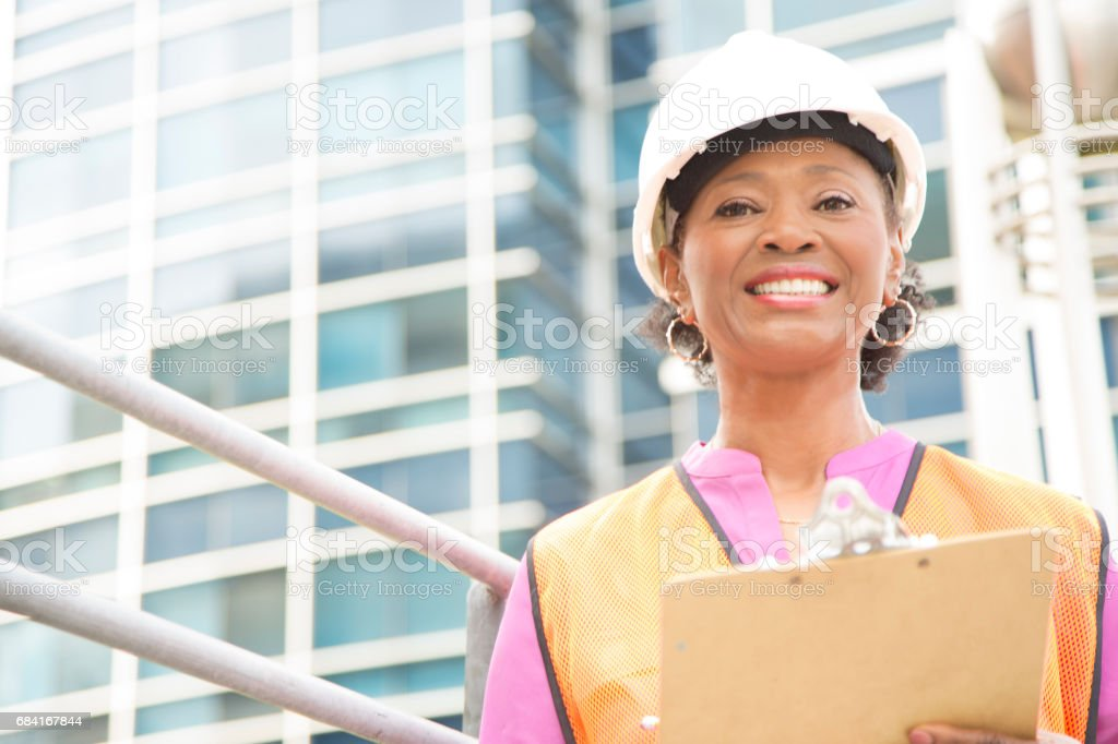 STEM Female engineer or architect working on a construction project in city. zbiór zdjęć royalty-free
