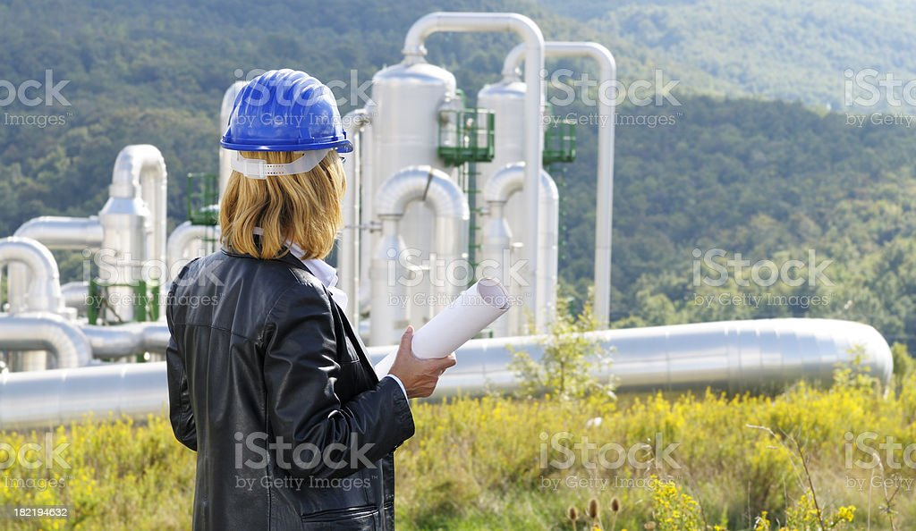 Female Engineer Planning in Geothermal Power Station royalty-free stock photo